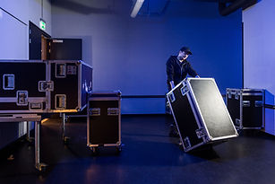 Roadie tipping a flightcase over on it's