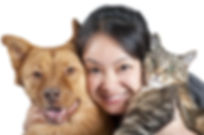 Woman hugging her dog and cat.jpg