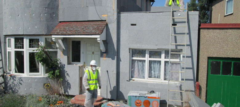 External solid wall insulation being installed