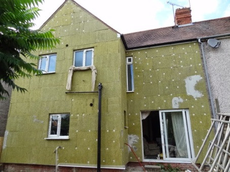 Mineral wool External solid wall insulation being installed