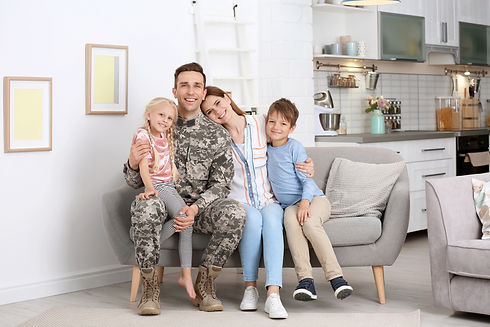 Man in military uniform with his family