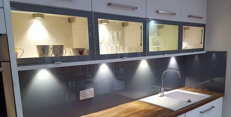 Grey glass splashbacks fitted on a modern kitchen in Liverpool, childwall, Merseyside, Northwest