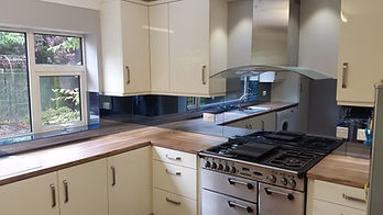 Grey tint mirror glass splashbacks, template supplied and fitted in Liverpool, Aintree, Maghull, Ormskirk, Lydiate, Kirkby Merseyside, Northwest