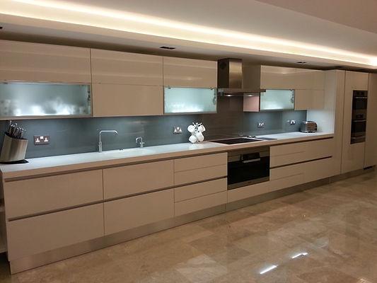 Grey glass splashback fitted in a german kitchen with corian worktops Liverpool, Merseyside, Nortwest
