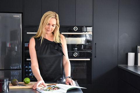 leanne looking at cook book.jpg