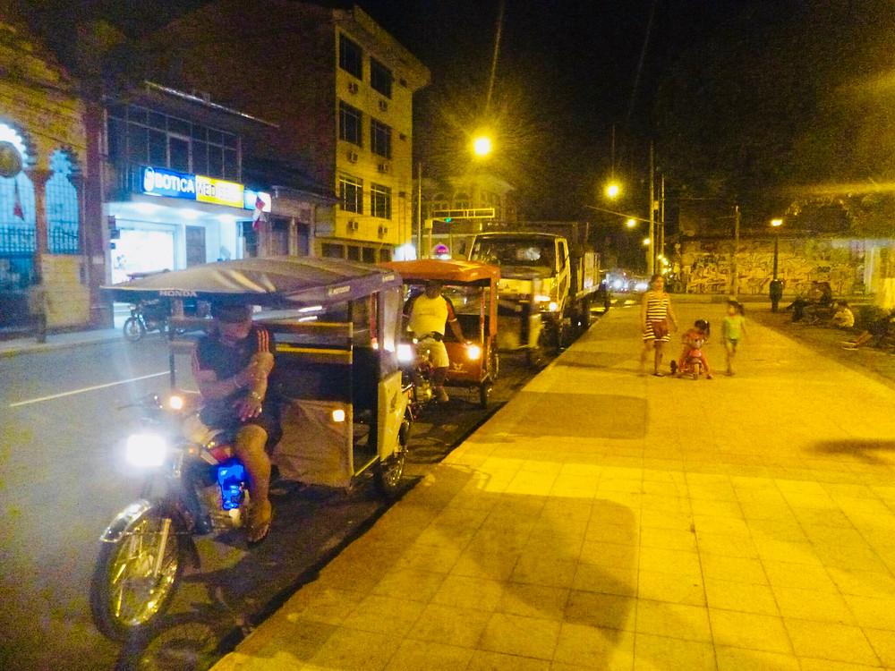 Tuk tuks lining up on the street