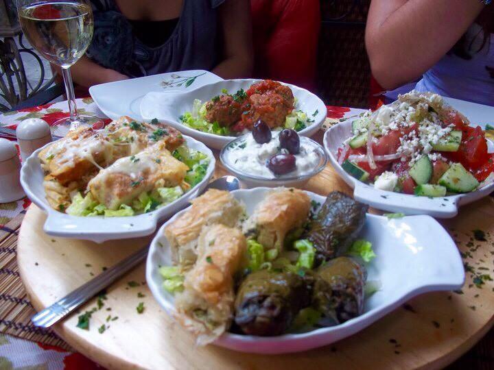 Greek salad, Dolmades, & other Greek dishes.