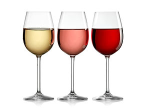 Red rose and white wine glasses in line.