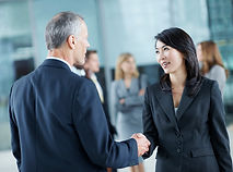 Male and Asian Female Shaking Hands copy