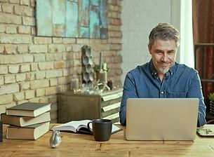 bigstock-Older-man-tele-working-with-la-