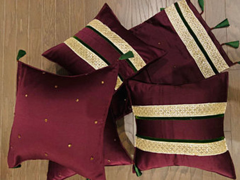 Set of 5 pieces, including 4cushion covers &1  Table Runner