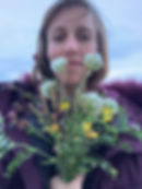 elise with hay field flowers.jpg
