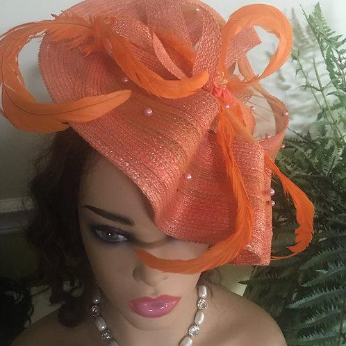 Orange feather fascinator hat