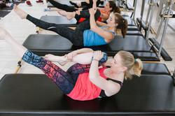 3 women in pilates class