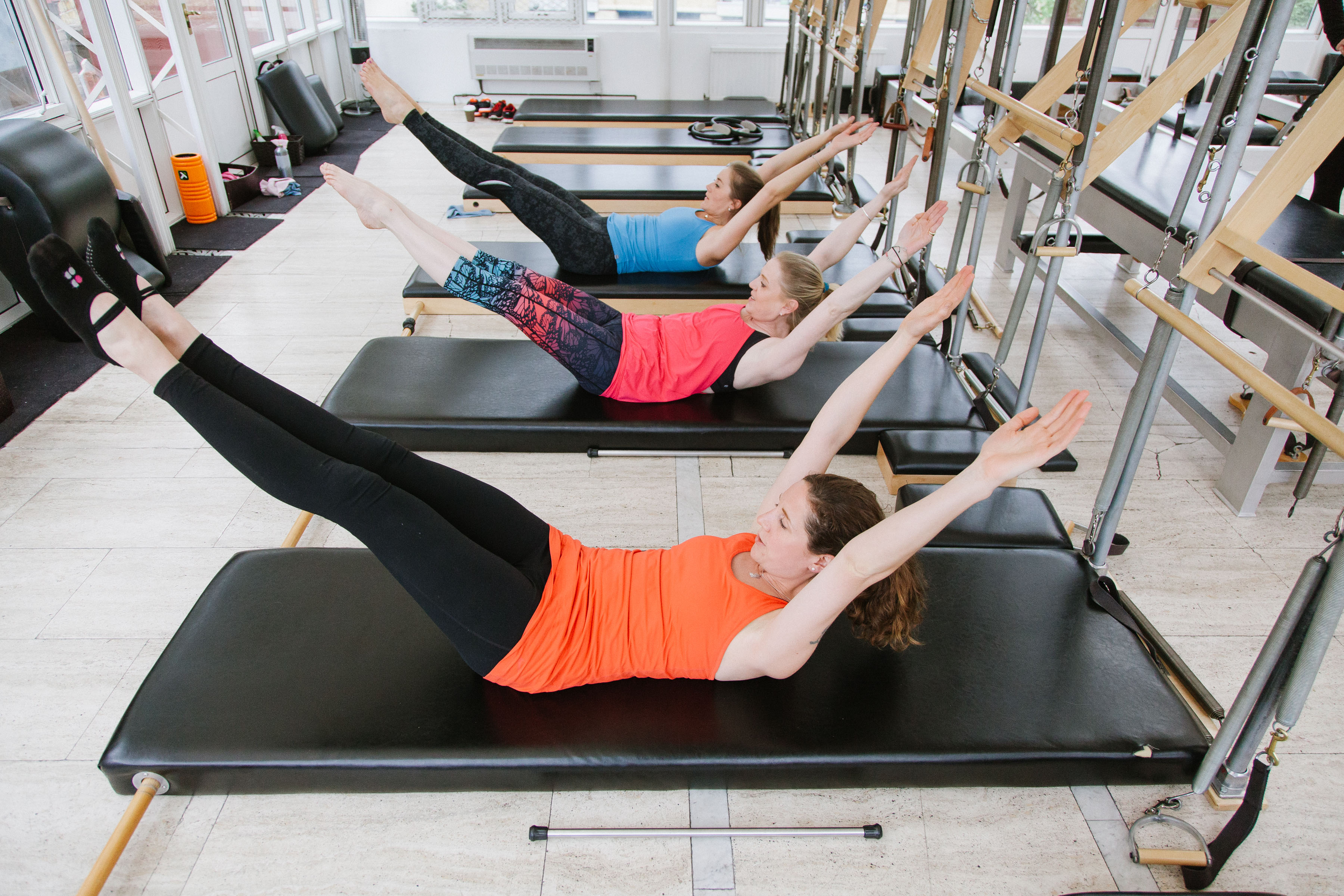 3 women on pilates equipment in Cirencester
