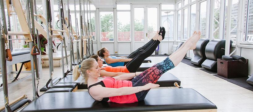 Lizzie Quaile instructing on pilates equipment