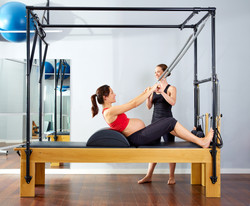 Pregnant women on pilates equipment