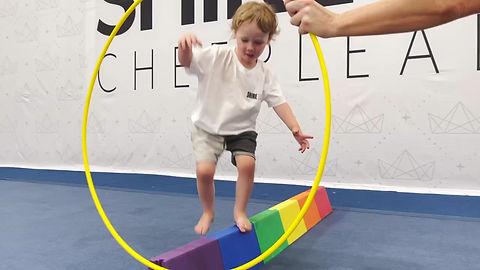 Tiny Tumbler kids learning balance and focus