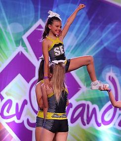 Cheer Sport Athletes performing stunt