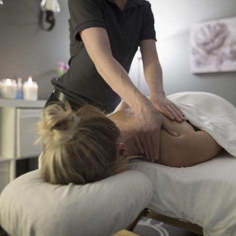 woman-receiving-massage-on-spa-massage-t