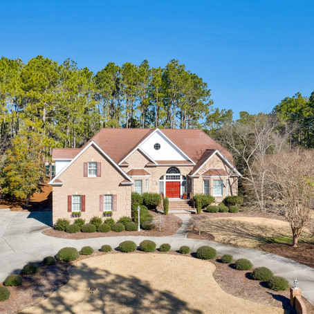 This gorgeous home welcomes you with a circular driveway, tasteful landscaping & elegant foyer. SOLD
