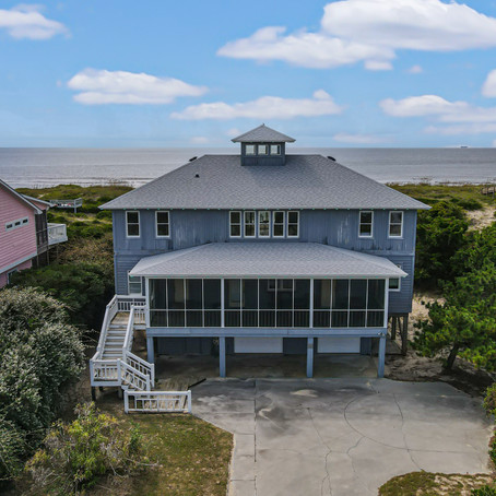 This spacious oceanfront home on beautiful Caswell Beach has the perfect location.