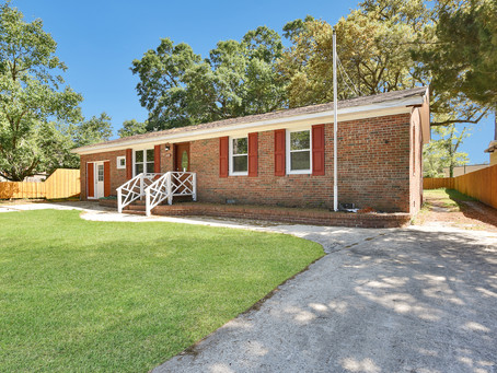 SOLD - This wonderful, recently renovated brick home is situated on a HUGE lot in Southport.