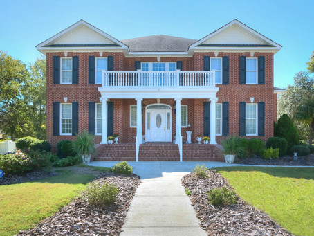 This very custom beautiful home is now available in The Landing at Southport - SOLD