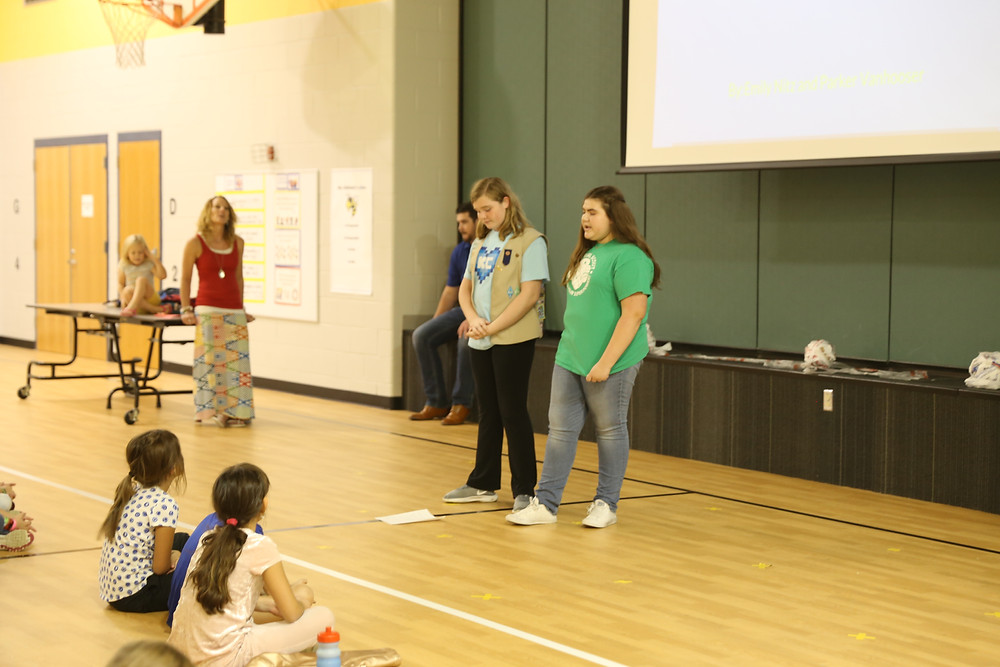 Girls Scouts explaining their Silver Award project.
