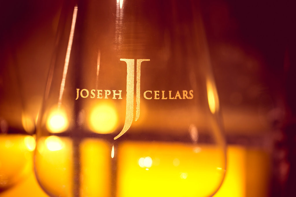 "A glass with ""Joseph Cellars"" etched inside"