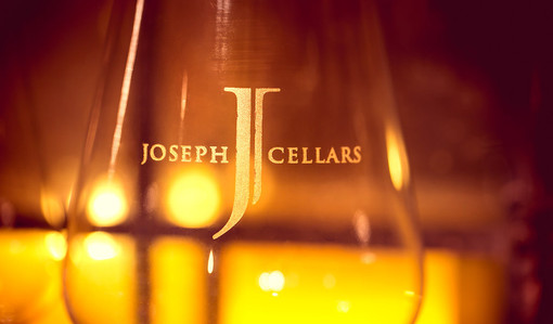 """A glass with """"Joseph Cellars"""" etched inside"""