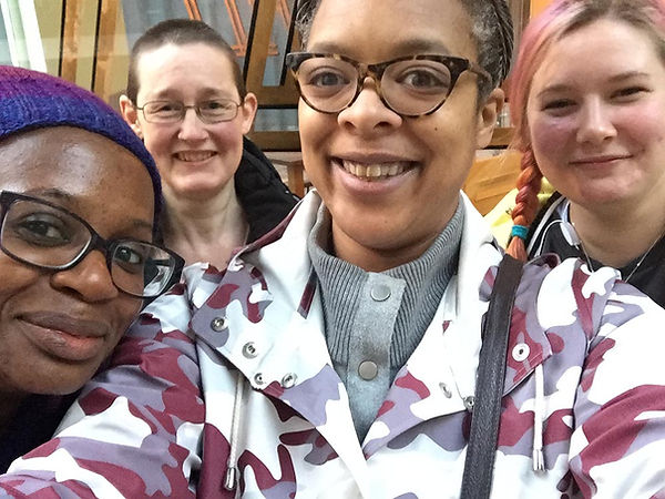 4 women huddle together in a selfie