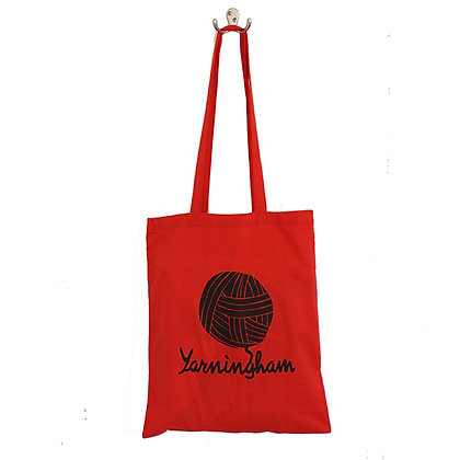Red cotton tote bag with long handles featuring Yarningham logo in black print