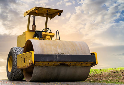 Road roller at road construction site wi