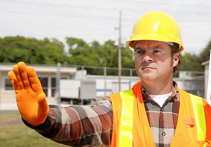 A construction worker holding a stop sig