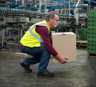 worker manually handling a box