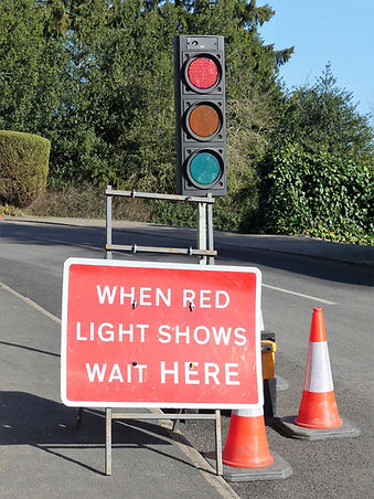 When red light shows wait here sign and