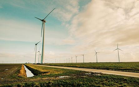 windmill-energy-on-green-grass-field-695