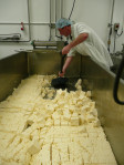 Shovelling the cubes of curd