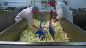 Andrew and Stu shovelling the large vat