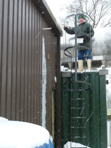 Stu removing snow from around the pipes into the whey tanks