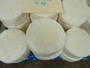 Some more newly bandaged cheeses ready to go into the maturing room to be naturally rinded