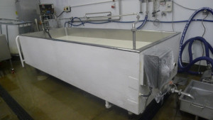 Pasteurised milk going in to the vat through the swinging arm