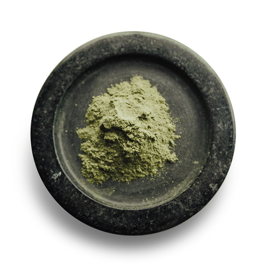 one table spoon of Hemp protein powder on black marble plate