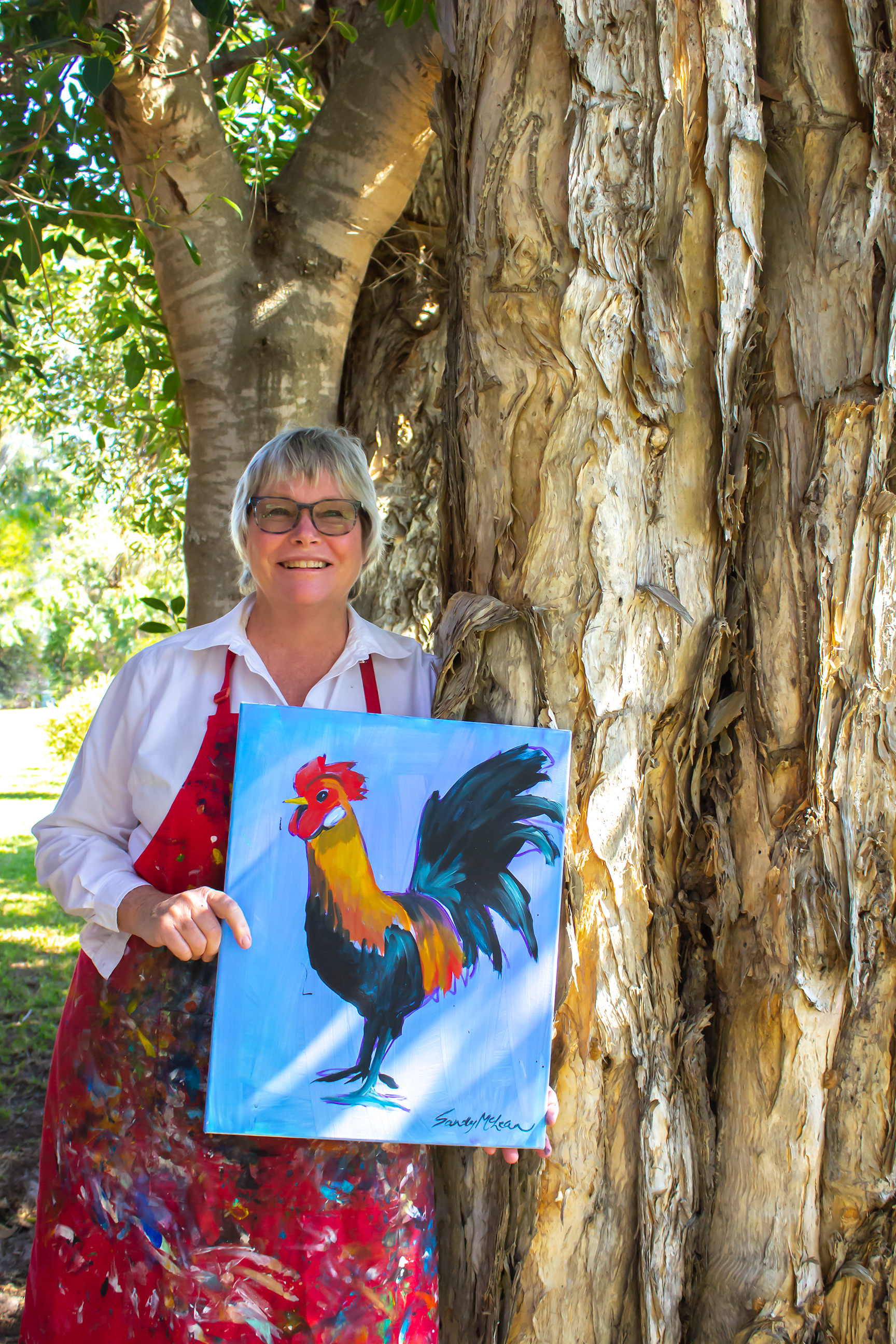 holding rooster painting_big smile_IMG_7