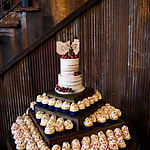 wedding cake naked with cupcakes.jpg