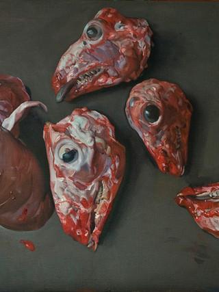 Asadura y tres cabezas de cordero y una cabeza de cabrito