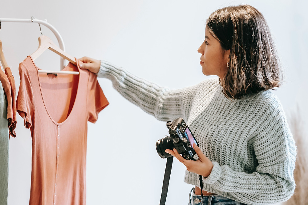 Woman taking a picture of clothing