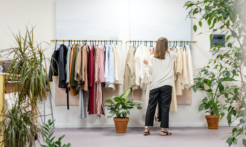 Woman searching through clothes rack