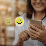 Businesswoman pressing face emoticon on